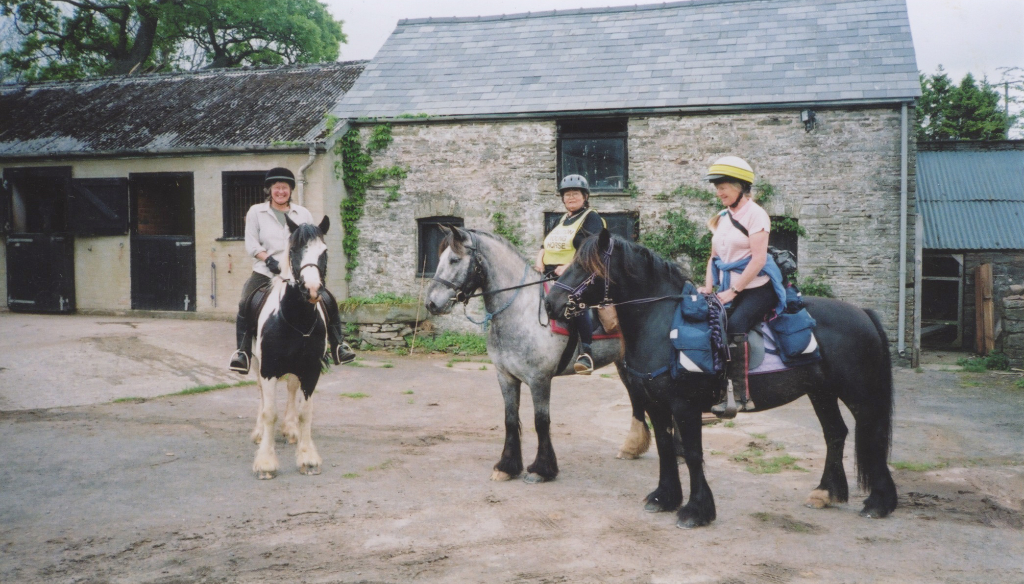 riders in a stable yard